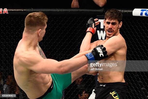 Marvin Vettori of Italy kicks Antonio Carlos Junior of Brazil in their middleweight bout during the UFC 207 event at TMobile Arena on December 30...
