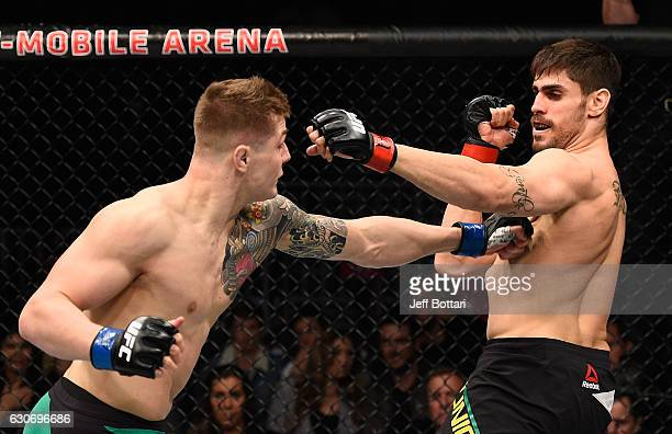 Marvin Vettori of Italy punches Antonio Carlos Junior of Brazil in their middleweight bout during the UFC 207 event at TMobile Arena on December 30...