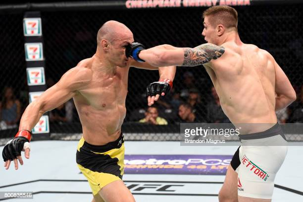 Marvin Vettori of Italy punches Vitor Miranda of Brazil in their middleweight bout during the UFC Fight Night event at the Chesapeake Energy Arena on...