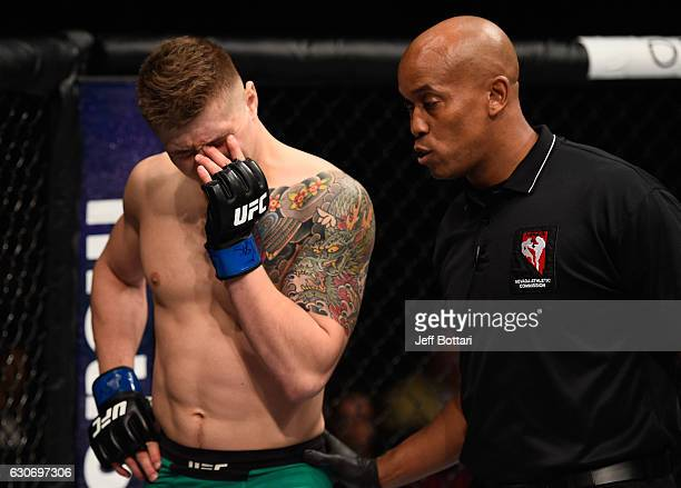 Marvin Vettori of Italy reacts to an eye poke from Antonio Carlos Junior of Brazil in their middleweight bout during the UFC 207 event at TMobile...
