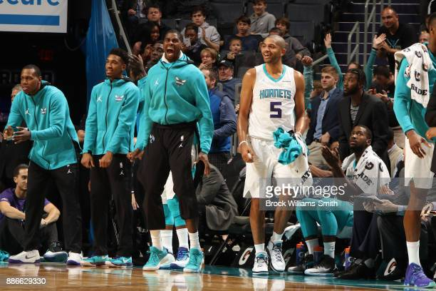 Marvin Williams and Nicolas Batum of the Charlotte Hornets react during game against the Orlando Magic on December 4 2017 at Spectrum Center in...