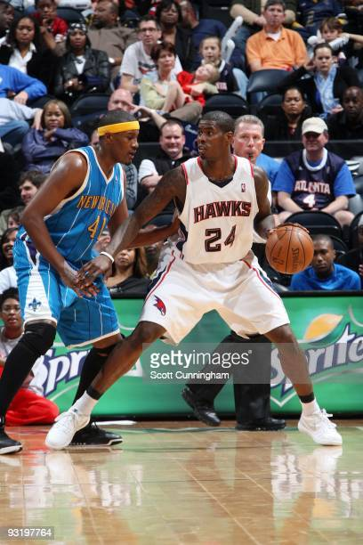 Marvin Williams of the Atlanta Hawks looks to make a move against James Posey of the New Orleans Hornets during the game at Philips Arena on November...