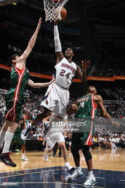 Marvin Williams of the Atlanta Hawks puts up a shot against Ersan Ilyasova of the Milwaukee Bucks in Game Seven of the Eastern Conference...