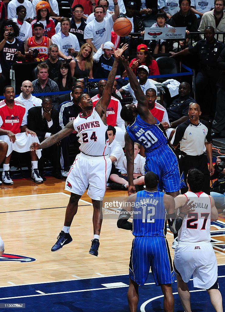 <a gi-track='captionPersonalityLinkClicked' href=/galleries/search?phrase=Marvin+Williams&family=editorial&specificpeople=206784 ng-click='$event.stopPropagation()'>Marvin Williams</a> #24 of the Atlanta Hawks rebounds against <a gi-track='captionPersonalityLinkClicked' href=/galleries/search?phrase=Brandon+Bass&family=editorial&specificpeople=233806 ng-click='$event.stopPropagation()'>Brandon Bass</a> #30 of the Orlando Magic in Game Three of the Eastern Conference Quarterfinals in the 2011 NBA Playoffs on April 22, 2011 at Philips Arena in Atlanta, Georgia.