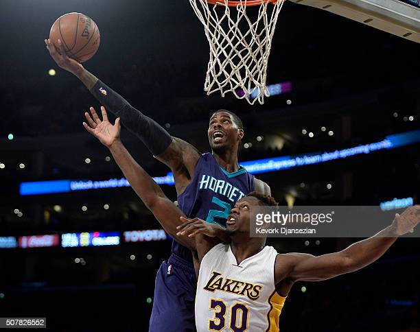 Marvin Williams of the Charlotte Hornets and Julius Randle of the Los Angeles Lakers battle for the rebound during the first half of the basketball...