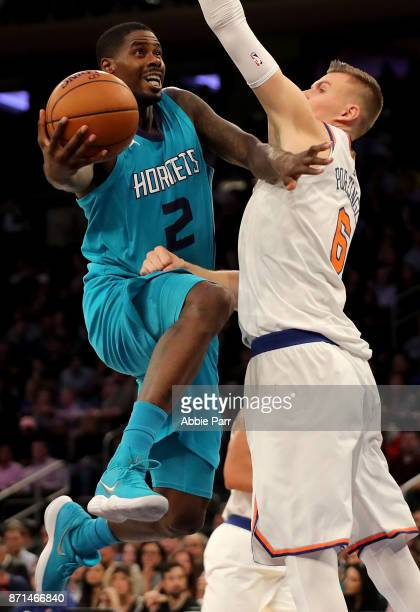 Marvin Williams of the Charlotte Hornets drives to the basket against Kristaps Porzingis of the New York Knicks in the second half during their game...
