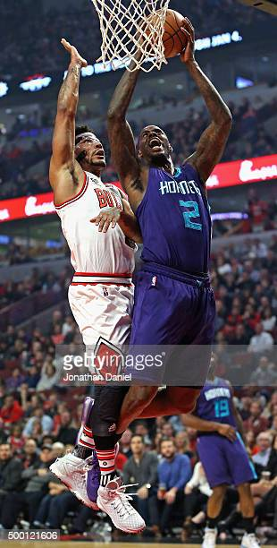 Marvin Williams of the Charlotte Hornets gets off a shot under pressure from Derrick Rose of the Chicago Bulls at the United Center on December 5...