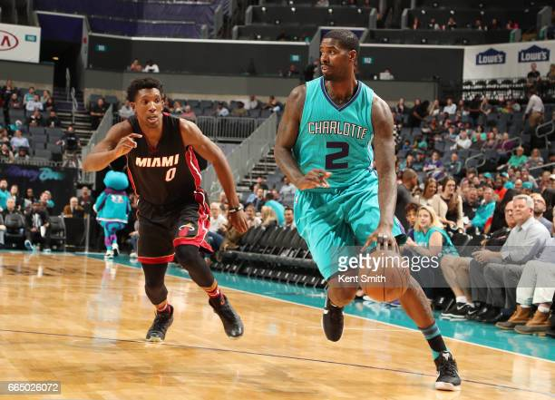 Marvin Williams of the Charlotte Hornets htb against Josh Richardson of the Miami Heat during the game on April 5 2017 at Spectrum Center in...