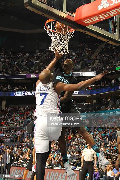 Marvin Williams of the Charlotte Hornets with the dunk against Carl Landry of the Philadelphia 76ers during the game at the Time Warner Cable Arena...