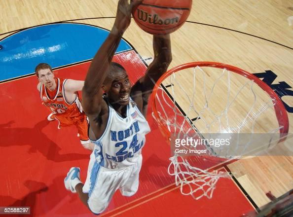 Marvin Williams of the North Carolina Tar Heels slam dunks the basketball against Jack Ingram of the Illinois Fighting Illini in the second half...