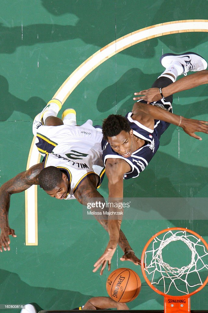 <a gi-track='captionPersonalityLinkClicked' href=/galleries/search?phrase=Marvin+Williams&family=editorial&specificpeople=206784 ng-click='$event.stopPropagation()'>Marvin Williams</a> #2 of the Utah Jazz and <a gi-track='captionPersonalityLinkClicked' href=/galleries/search?phrase=Hasheem+Thabeet&family=editorial&specificpeople=4003778 ng-click='$event.stopPropagation()'>Hasheem Thabeet</a> #34 of the Oklahoma City Thunder go up for a rebound on February 12, 2013 in Salt Lake City, Utah.