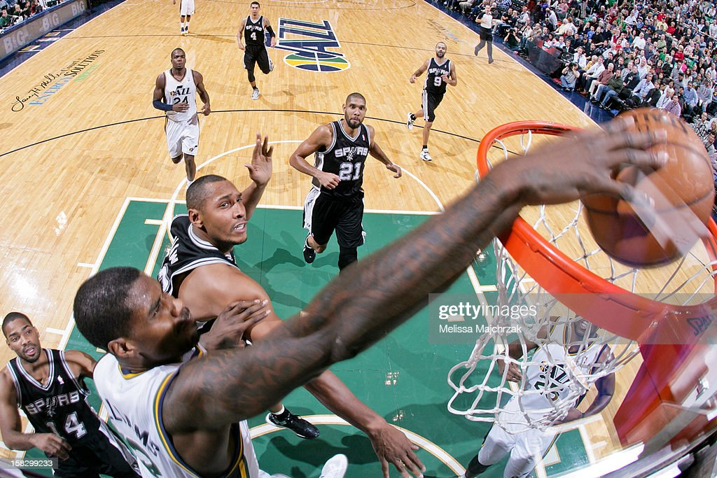 <a gi-track='captionPersonalityLinkClicked' href=/galleries/search?phrase=Marvin+Williams&family=editorial&specificpeople=206784 ng-click='$event.stopPropagation()'>Marvin Williams</a> #2 of the Utah Jazz dunks against <a gi-track='captionPersonalityLinkClicked' href=/galleries/search?phrase=Boris+Diaw&family=editorial&specificpeople=201505 ng-click='$event.stopPropagation()'>Boris Diaw</a> #33 of the San Antonio Spurs at Energy Solutions Arena on December 12, 2012 in Salt Lake City, Utah.