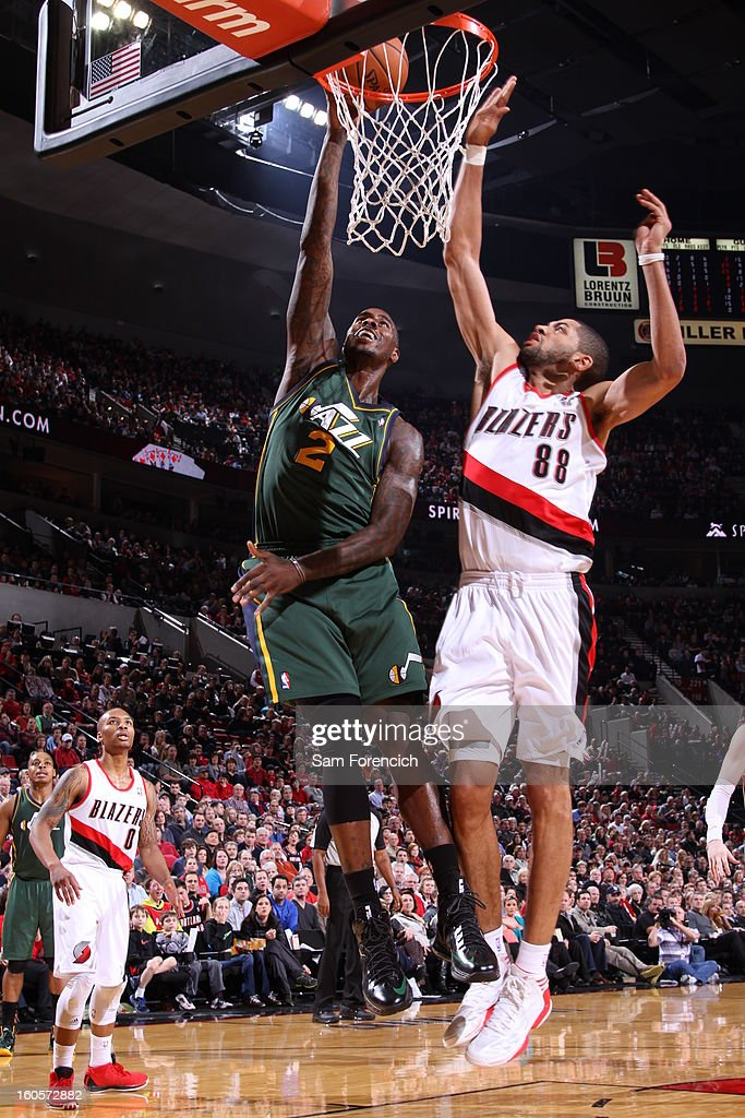 Marvin Williams #2 of the Utah Jazz goes to the basket against Nicolas Batum #88 of the Portland Trail Blazers during the game between the Utah Jazz and the Portland Trail Blazers on February 2, 2013 at the Rose Garden Arena in Portland, Oregon.