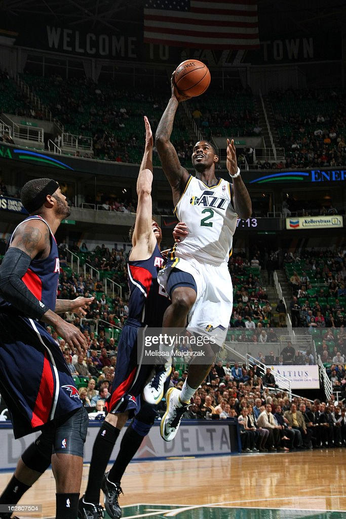 Marvin Williams #2 of the Utah Jazz goes up for the shot against Kyle Korver #24 of the Atlantic Hawks at Energy Solutions Arena on February 27, 2013 in Salt Lake City, Utah.