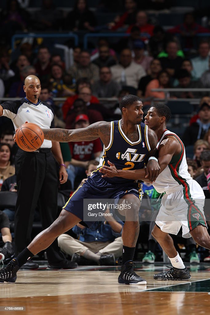 <a gi-track='captionPersonalityLinkClicked' href=/galleries/search?phrase=Marvin+Williams&family=editorial&specificpeople=206784 ng-click='$event.stopPropagation()'>Marvin Williams</a> #2 of the Utah Jazz handles the ball against the Milwaukee Bucks on March 3, 2014 at the BMO Harris Bradley Center in Milwaukee, Wisconsin.