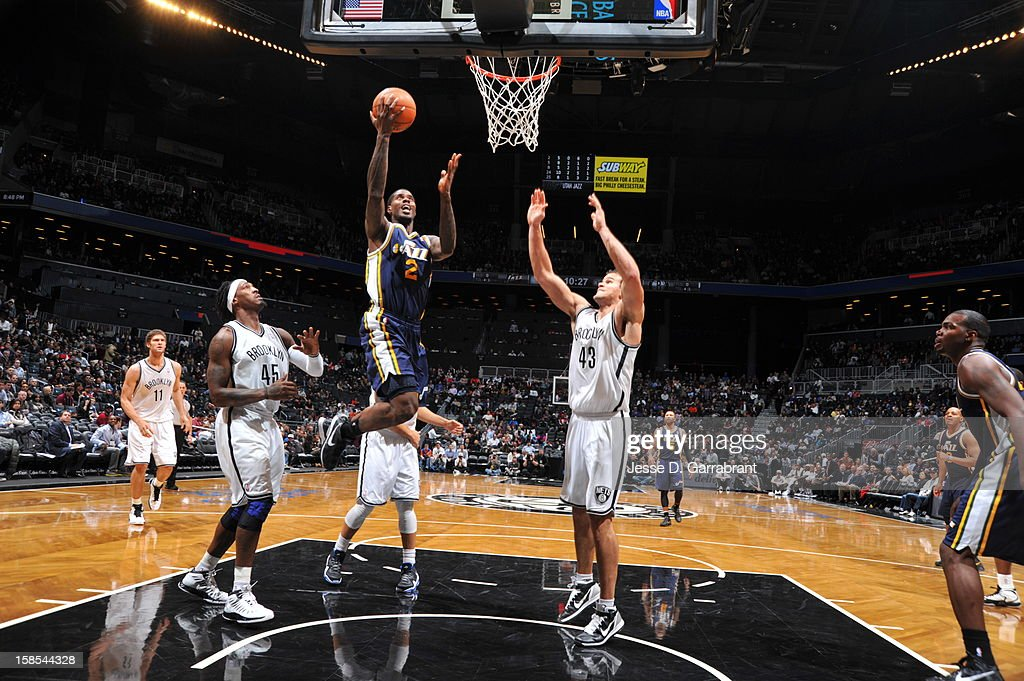 <a gi-track='captionPersonalityLinkClicked' href=/galleries/search?phrase=Marvin+Williams&family=editorial&specificpeople=206784 ng-click='$event.stopPropagation()'>Marvin Williams</a> #2 of the Utah Jazz rises for a layup against <a gi-track='captionPersonalityLinkClicked' href=/galleries/search?phrase=Gerald+Wallace&family=editorial&specificpeople=202117 ng-click='$event.stopPropagation()'>Gerald Wallace</a> #45 and <a gi-track='captionPersonalityLinkClicked' href=/galleries/search?phrase=Kris+Humphries&family=editorial&specificpeople=209199 ng-click='$event.stopPropagation()'>Kris Humphries</a> #43 of the Brooklyn Nets during the game at the Barclays Center on December 18, 2012 in Brooklyn, New York.
