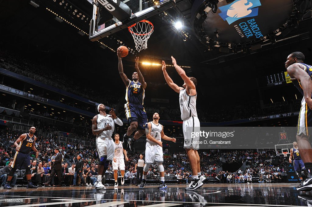 <a gi-track='captionPersonalityLinkClicked' href=/galleries/search?phrase=Marvin+Williams&family=editorial&specificpeople=206784 ng-click='$event.stopPropagation()'>Marvin Williams</a> #2 of the Utah Jazz rises for a layup against the Brooklyn Nets during the game at the Barclays Center on December 18, 2012 in Brooklyn, New York.