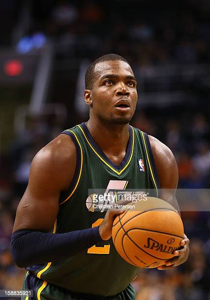 Marvin Williams of the Utah Jazz shoots a free throw shot during the NBA game against the Phoenix Suns at US Airways Center on December 14 2012 in...