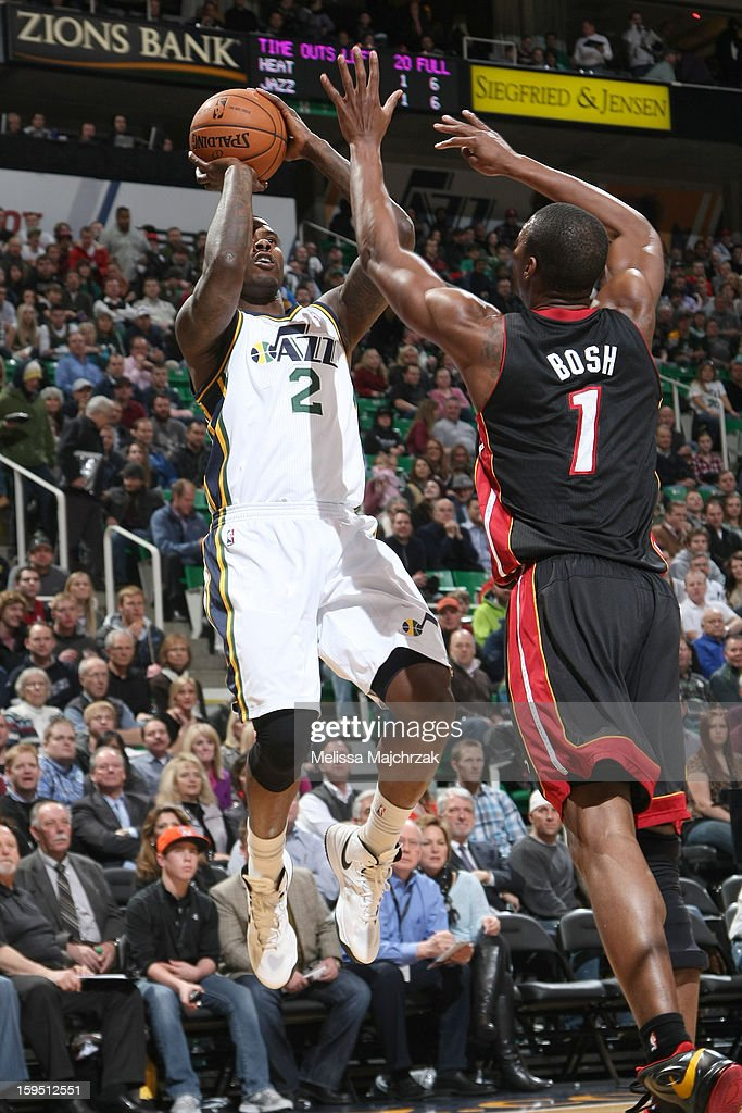 Marvin Williams #2 of the Utah Jazz shoots against Chris Bosh #1 of the Miami Heat at Energy Solutions Arena on January 14, 2013 in Salt Lake City, Utah.
