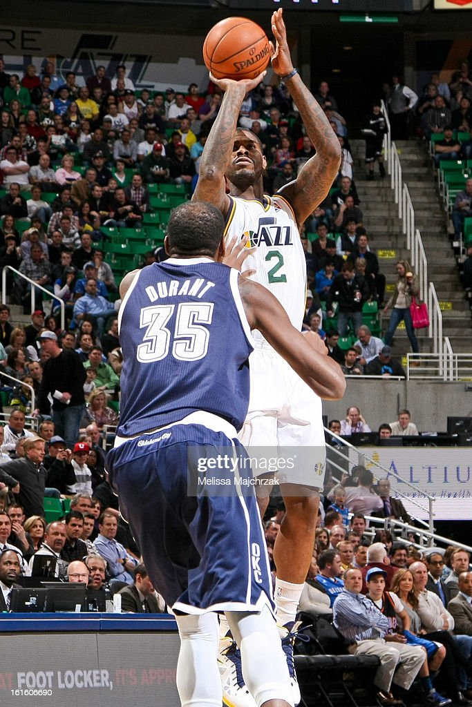 Marvin Williams #2 of the Utah Jazz shoots against Kevin Durant #35 of the Oklahoma City Thunder at Energy Solutions Arena on February 12, 2013 in Salt Lake City, Utah.