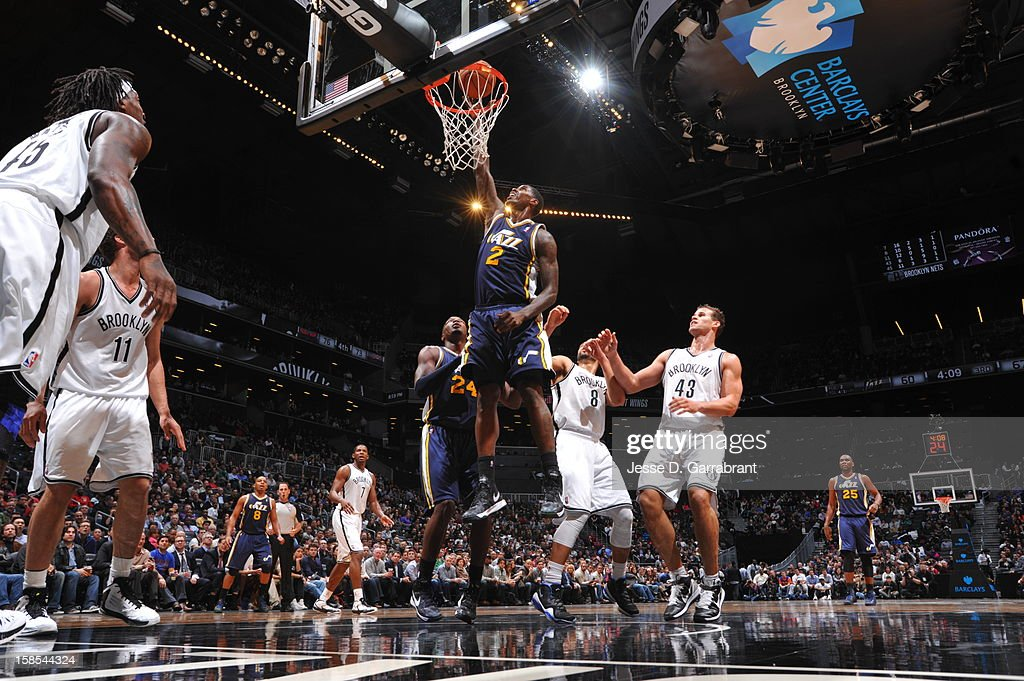 <a gi-track='captionPersonalityLinkClicked' href=/galleries/search?phrase=Marvin+Williams&family=editorial&specificpeople=206784 ng-click='$event.stopPropagation()'>Marvin Williams</a> #2 of the Utah Jazz shoots against the Brooklyn Nets during the game at the Barclays Center on December 18, 2012 in Brooklyn, New York.