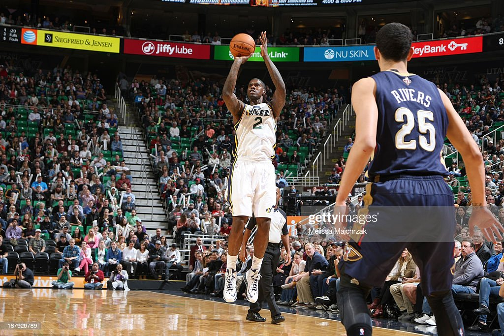 <a gi-track='captionPersonalityLinkClicked' href=/galleries/search?phrase=Marvin+Williams&family=editorial&specificpeople=206784 ng-click='$event.stopPropagation()'>Marvin Williams</a> #2 of the Utah Jazz shoots against the New Orleans Pelicans at EnergySolutions Arena on November 13, 2013 in Salt Lake City, Utah.