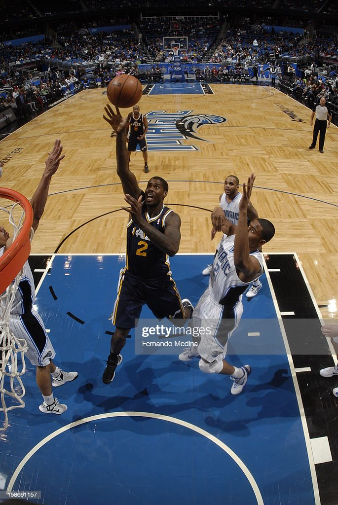 <a gi-track='captionPersonalityLinkClicked' href=/galleries/search?phrase=Marvin+Williams&family=editorial&specificpeople=206784 ng-click='$event.stopPropagation()'>Marvin Williams</a> #2 of the Utah Jazz throws up a floater against the Orlando Magic during the game on December 23, 2012 at Amway Center in Orlando, Florida.