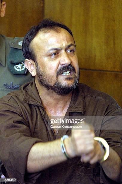 Marwan Barghouti the West bank chief of Yasser Arafat's Fatah movement talks to the media in the courtroom on the opening day of his court case at...