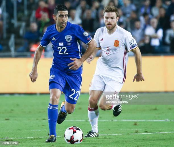Marwan Kabha of Spain in action against Asier Illarramendi of Israel during the 2018 FIFA World Cup European Group G qualifying football match...