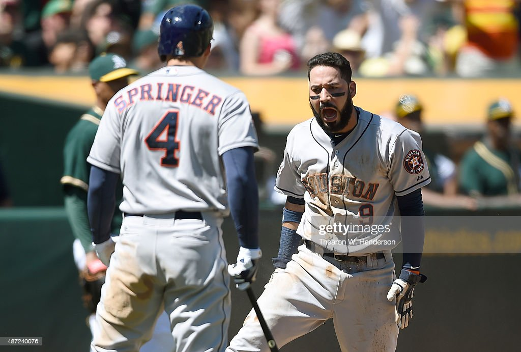 Marwin Gonzalez and George Springer of the Houston Astros celebrates after Gonzalez scored against the Oakland Athletics in the top of the second...
