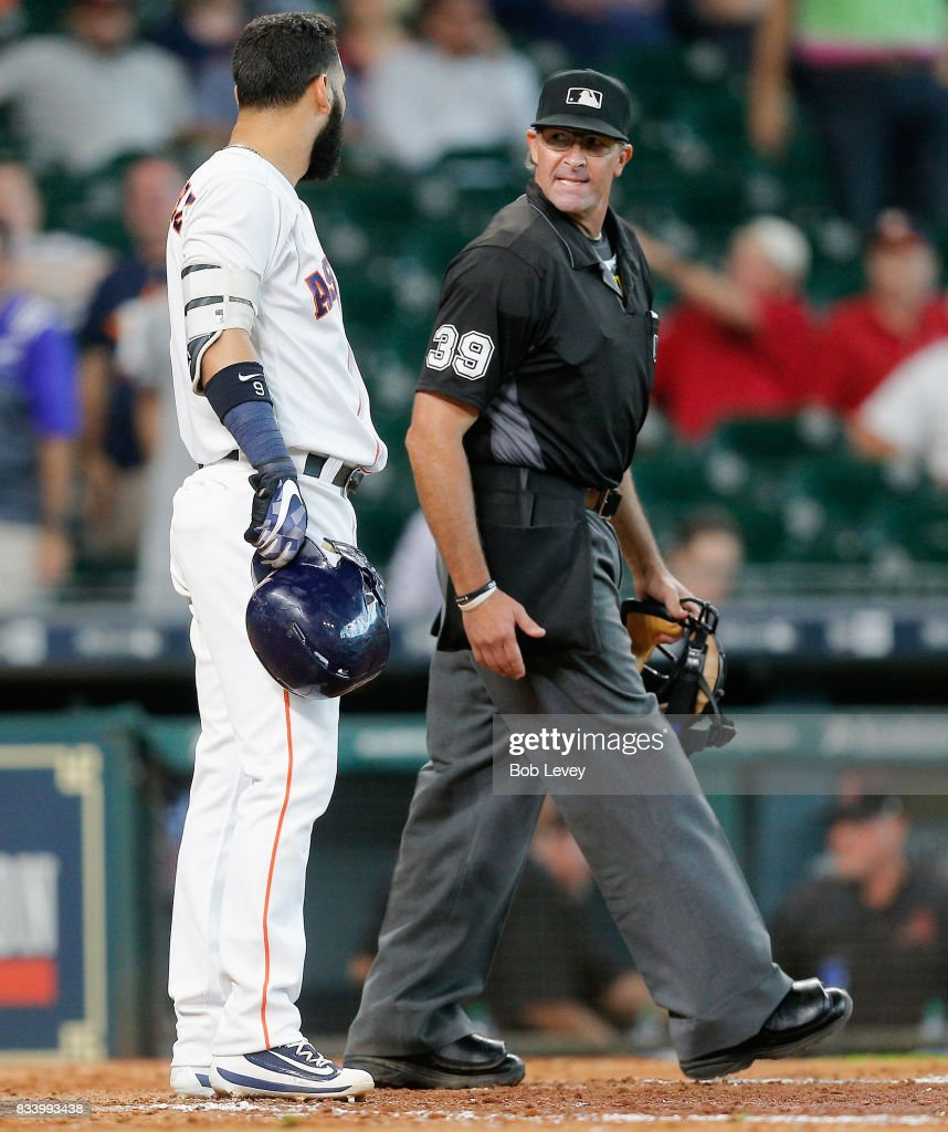 Marwin Gonzalez #9 of the Houston Astros argues with home plate umpire Paul Nauert after he was called out on strikes to end the game against the Arizona Diamondbacks at Minute Maid Park on August 17, 2017 in Houston, Texas.