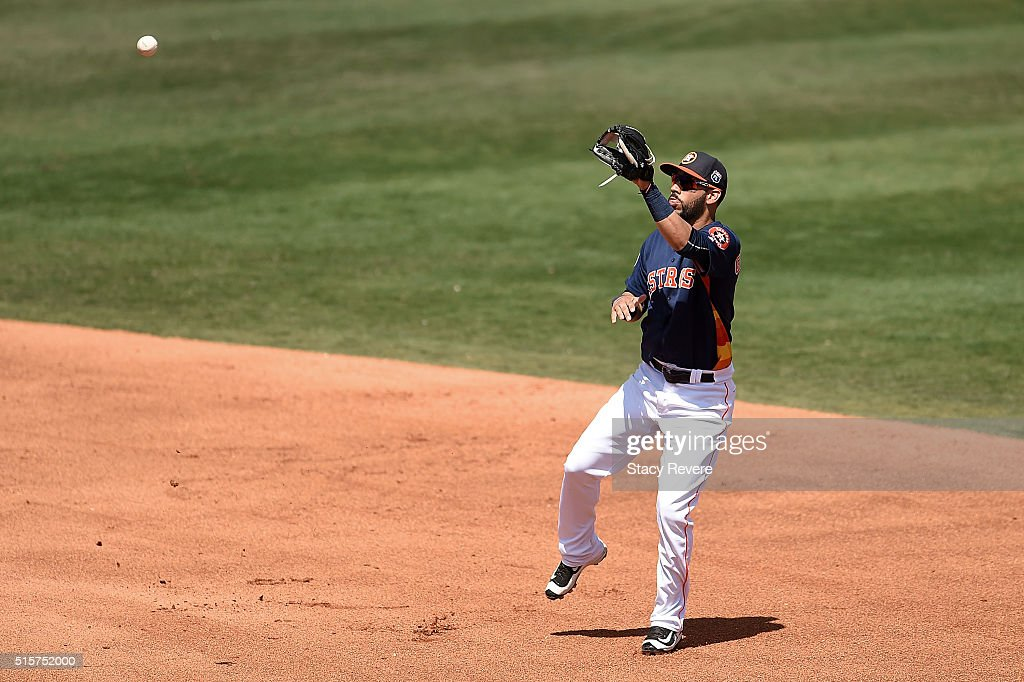 Marwin Gonzalez of the Houston Astros cathes a line drive during the fourth inning of a spring training game against the Washington Nationals at...