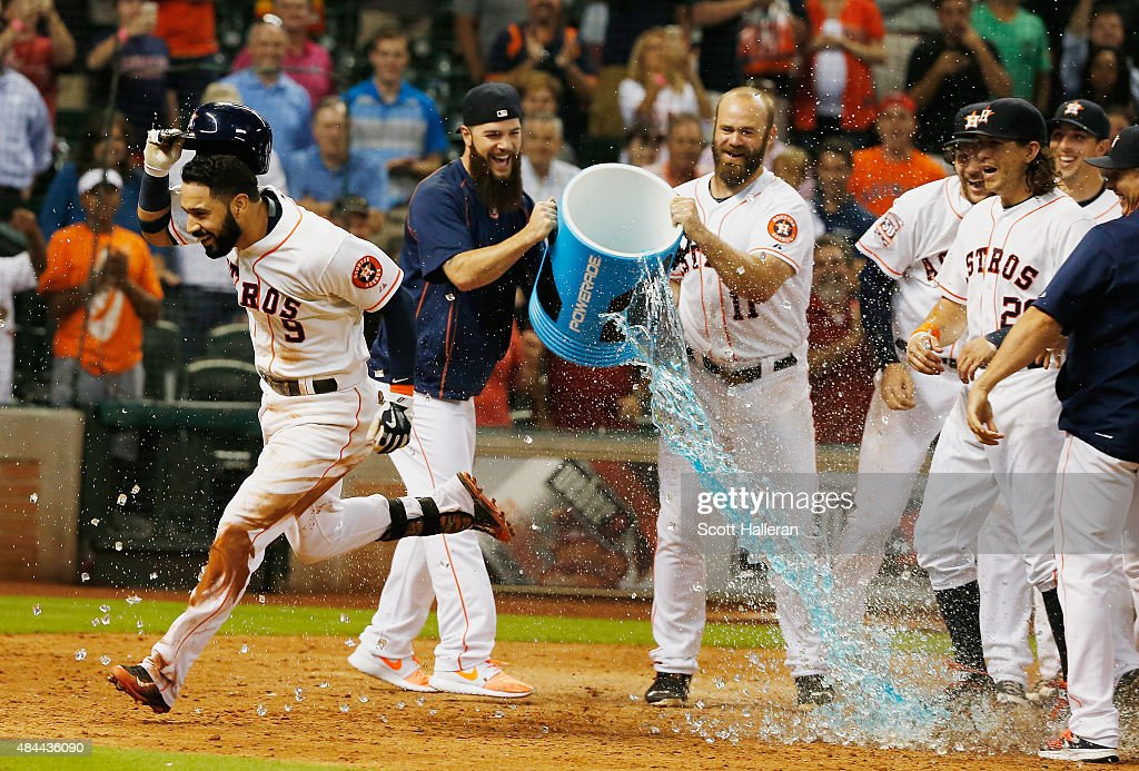 Marwin Gonzalez of the Houston Astros celebrates with his teammates after his solo home run in the tenth inning to defeat the Tampa Bay Rays 32 at...