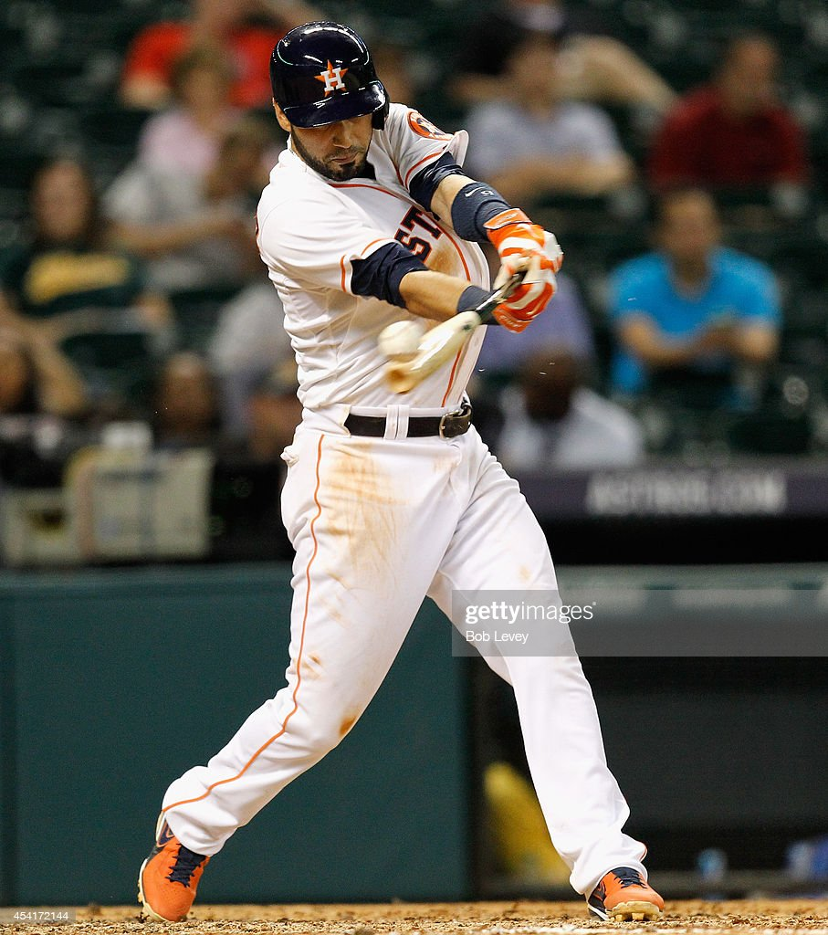 Marwin Gonzalez of the Houston Astros doubles in the ninth inning against the Oakland Athletics at Minute Maid Park on August 25 2014 in Houston Texas