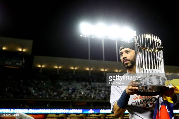 Marwin Gonzalez of the Houston Astros holds the Commissioner's Trophy after defeating the Los Angeles Dodgers 51 in game seven to win the 2017 World...