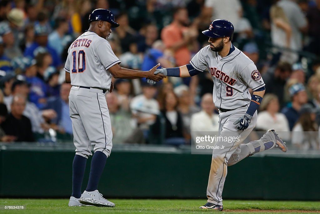 Marwin Gonzalez #9 of the Houston Astros is congratulated by third base coach Gary Pettis #10 on a solo homer in the seventh inning against the Seattle Mariners at Safeco Field on July 15, 2016 in Seattle, Washington.