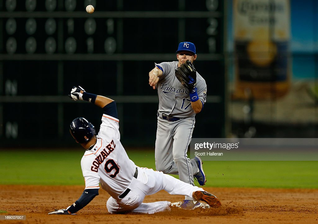 Marwin Gonzalez #20 of the Houston Astros is forced out at second base during the third inning by <a gi-track='captionPersonalityLinkClicked' href=/galleries/search?phrase=Chris+Getz&family=editorial&specificpeople=4936717 ng-click='$event.stopPropagation()'>Chris Getz</a> #17 of the Kansas City Royals at Minute Maid Park on May 21, 2013 in Houston, Texas.