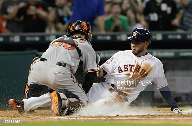 Marwin Gonzalez of the Houston Astros is tagged out at home by Caleb Joseph of the Baltimore Orioles trying to score on a single by Jose Altuve in...