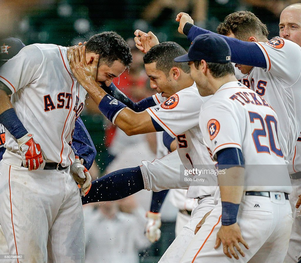 Marwin Gonzalez of the Houston Astros left is congratulated by Carlos Correa and Preston Tucker after hitting a game winning home run in the...