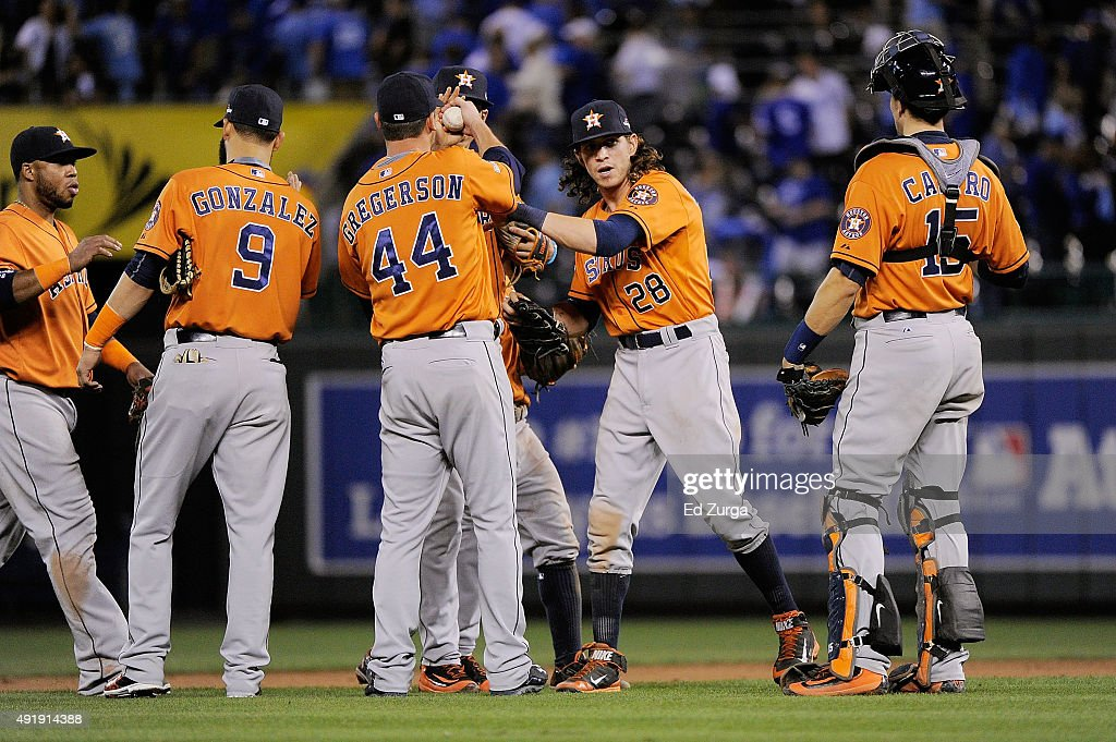 Marwin Gonzalez #9 of the Houston Astros, Luke Gregerson #44 of the Houston Astros, Colby Rasmus #28 of the Houston Astros, and Jason Castro #15 of the Houston Astros celebrate defeating the Kansas City Royals in game one of the American League Division Series at Kauffman Stadium on October 8, 2015 in Kansas City, Missouri. The Houston Astros defeat the Kansas City Royals with a score of 5 to 2.