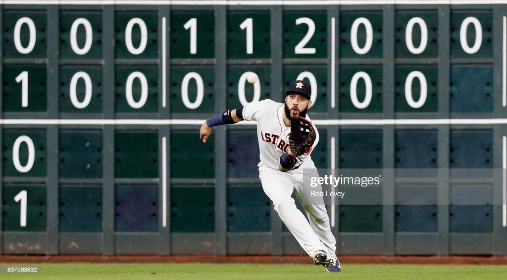 Marwin Gonzalez #9 of the Houston Astros makes a catch in the eighth inning against the Washington Nationals at Minute Maid Park on August 22, 2017 in Houston, Texas.