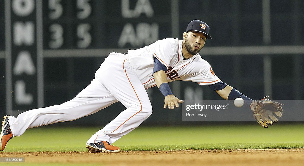 Marwin Gonzalez of the Houston Astros makes a diving attempt on a ball hit up the middle during action against the Oakland Athletics at Minute Maid...