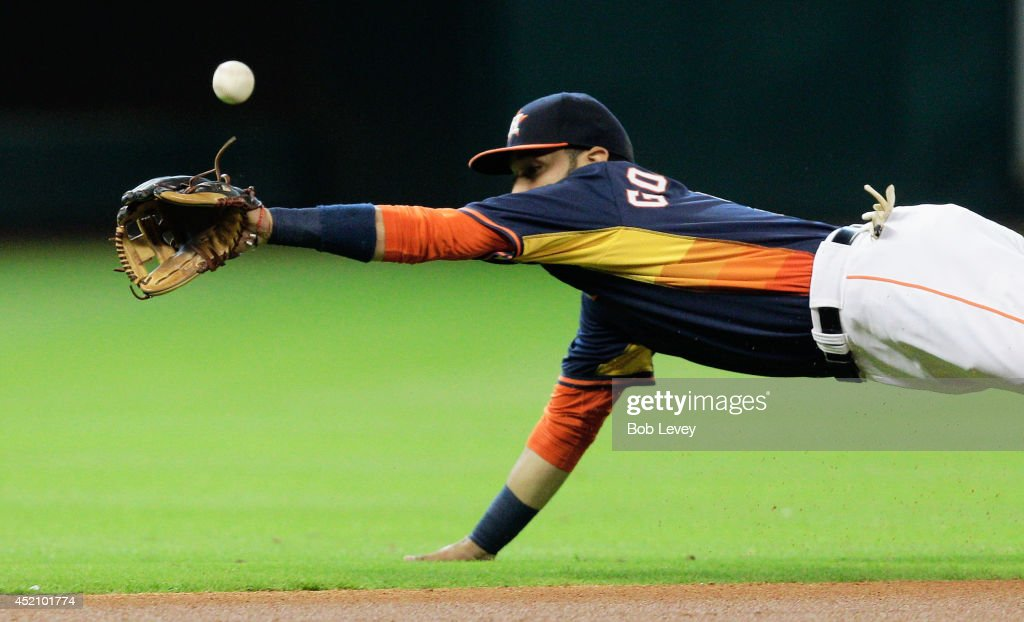 Marwin Gonzalez of the Houston Astros makes a diving attempt on ball hit by Dustin Pedroia of the Boston Red Sox in the first inning at Minute Maid...