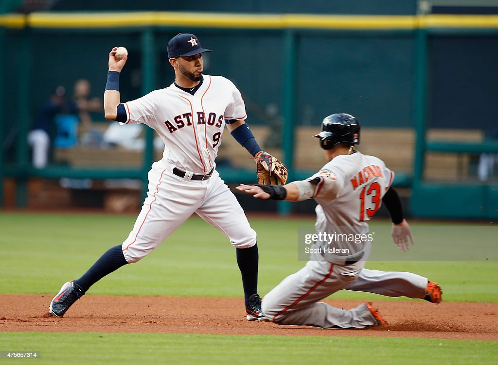 Marwin Gonzalez of the Houston Astros makes a play at second base on Manny Machado of the Baltimore Orioles in the first inning during their game at...