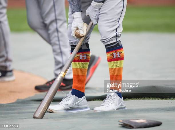 Marwin Gonzalez of the Houston Astros puts pine tar on his bat during batting practice before a game against the Seattle Mariners at Safeco Field on...