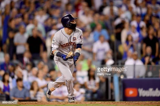 Marwin Gonzalez of the Houston Astros reacts after hitting a solo home run during the ninth inning against the Los Angeles Dodgers in game two of the...