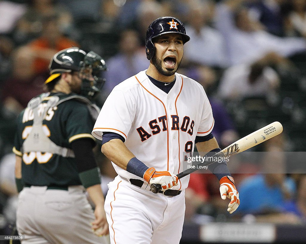 Marwin Gonzalez of the Houston Astros reacts after striking out in the eighth inning against the Oakland Athletics at Minute Maid Park on August 27...