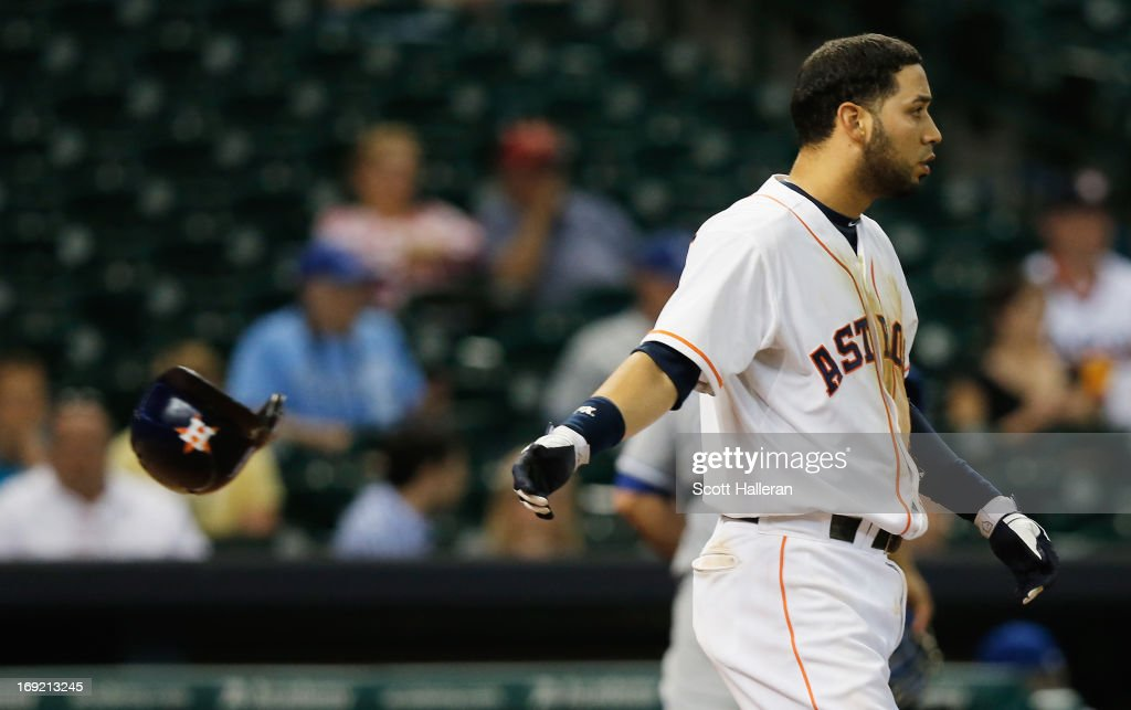 Marwin Gonzalez of the Houston Astros reacts to striking out to end the eighth inning against the Kansas City Royals at Minute Maid Park on May 21...