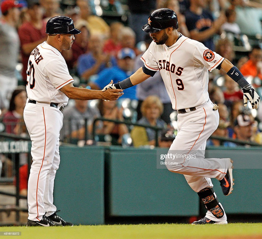 Marwin Gonzalez #9 of the Houston Astros receives congratulations from Pat Listach #20 after hitting a home run against the Seattle Mariners at Minute Maid Park on July 2, 2014 in Houston, Texas.