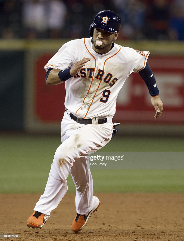 Marwin Gonzalez #9 of the Houston Astros rounds second base on a single by Jose Altuve #27 of the Houston Astros in the ninth inning against the Texas Rangers at Minute Maid Park on April 2, 2013 in Houston, Texas. Gonzalez's single broke up a perfect game for Yu Darvish.